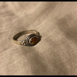 Sterling silver ring with orange colored opal